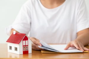 woman holding a papers for her house property